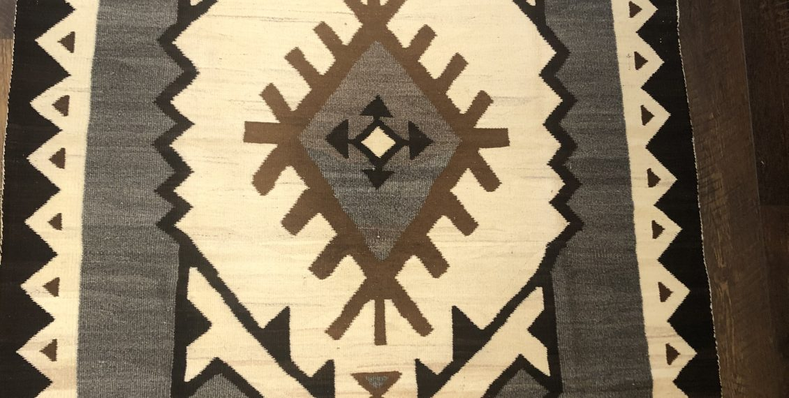 An excellent circa 1910 to 1915 JB Moore Crystal Navajo Native American Rug with variegated natural whites and the natural brown color used by JB Moore