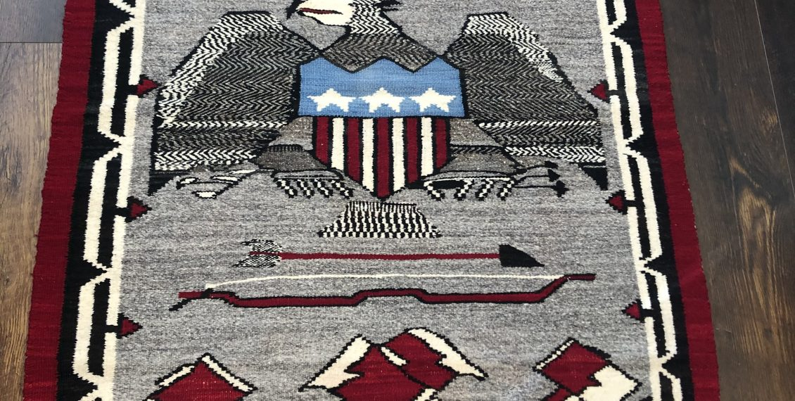 an excellent 1940 to 1950 navajo pictorial rug with a great design including bow and arrows and an eagle