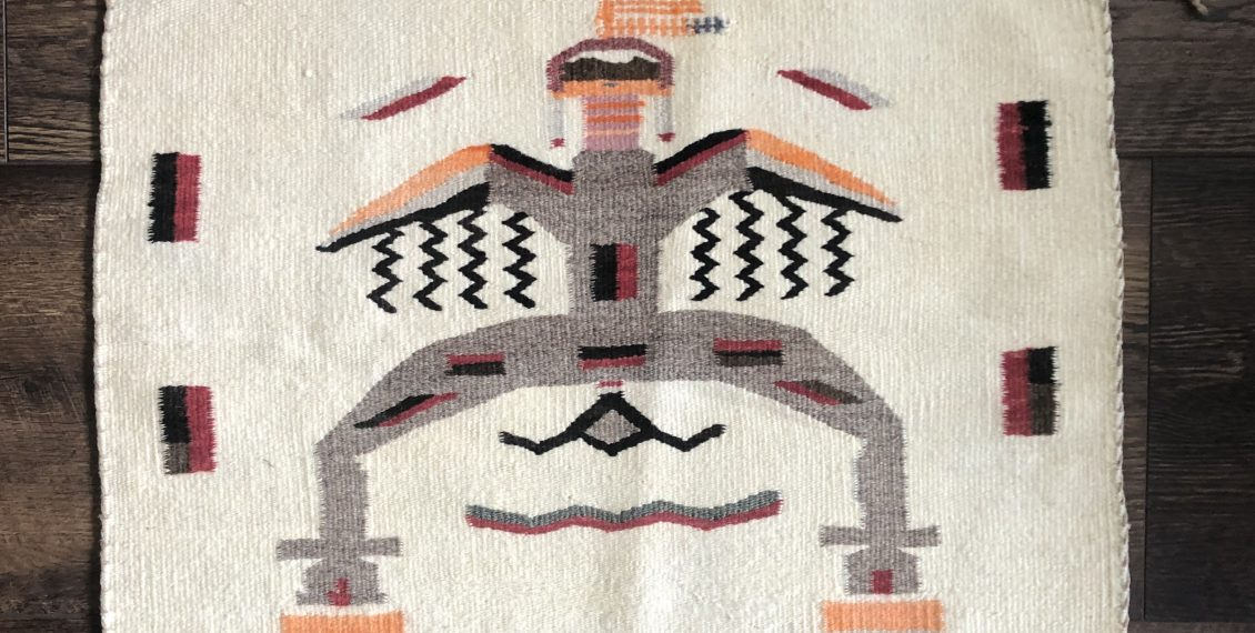 a navajo rug with a dragon slayer design from the 1920s in very good conditon.