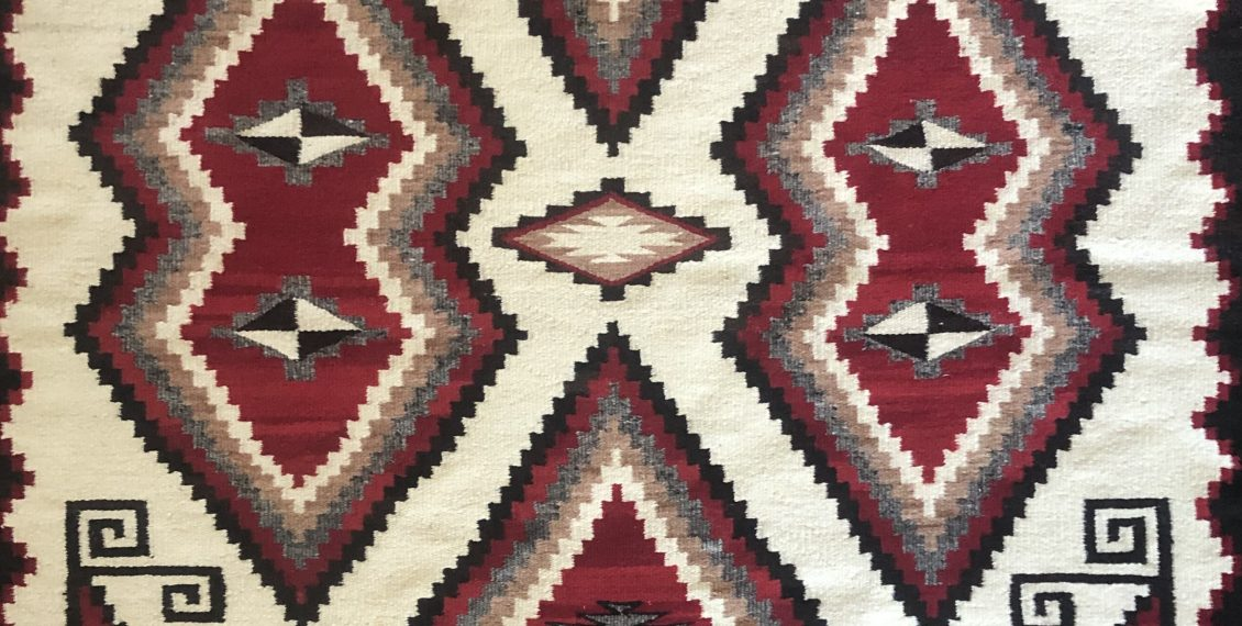 Here is a Circa 1930s 1940s Navajo rug. It's in pretty good shape with a couple of minor stains.