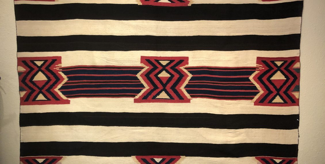 Here is a circa 1865 to 1870 Navajo Second Phase Chief's Variant blanket for sale. It is in excellent condition. All of the red is cochhineal dye byetta. The blanket also has Indigo blue, homespun white, homespun rabbit brush yellow and 3 ply purple
