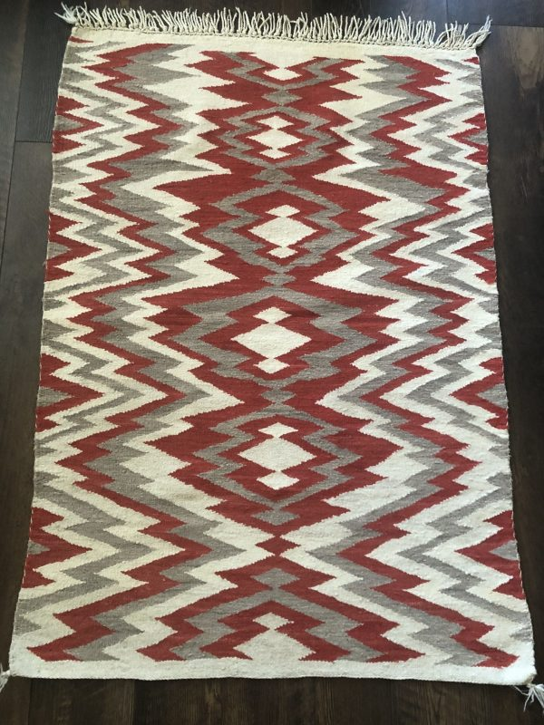 An excellent late 1890s transitional blanket with exposed warp fringe. It's in great condition but could use a cleaning.