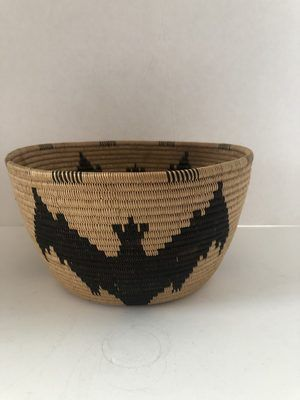 A very unique Native American paniment basket with bats in excellent condition.