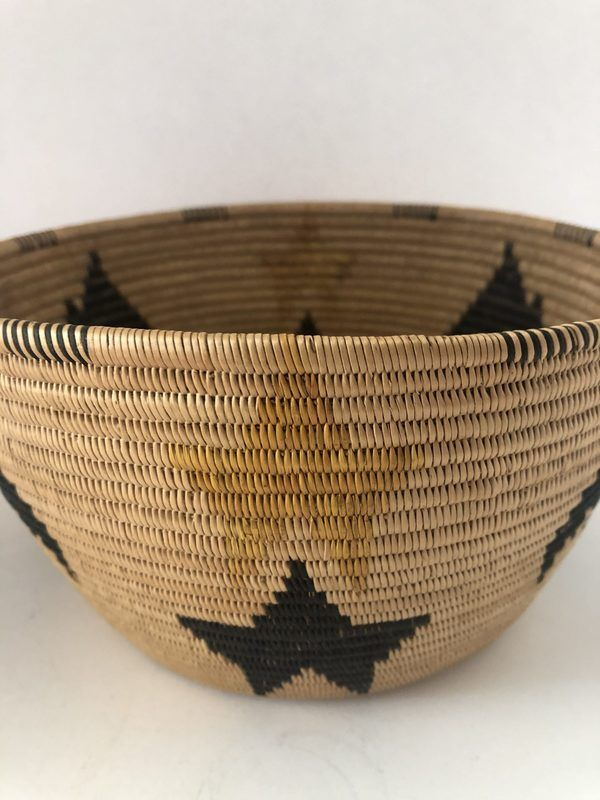 A very unique Native American Southern Panamint basket with a bat design in excellent condition.