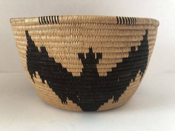 """A very unique Native American Southern Panamint basket with a bat design in excellent condition. 4 1/4"""" wide and 8"""" tall"""
