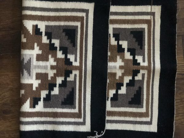 a very nice, small Two Grey Hills Navajo rug. Finely woven and in excellent conditon.
