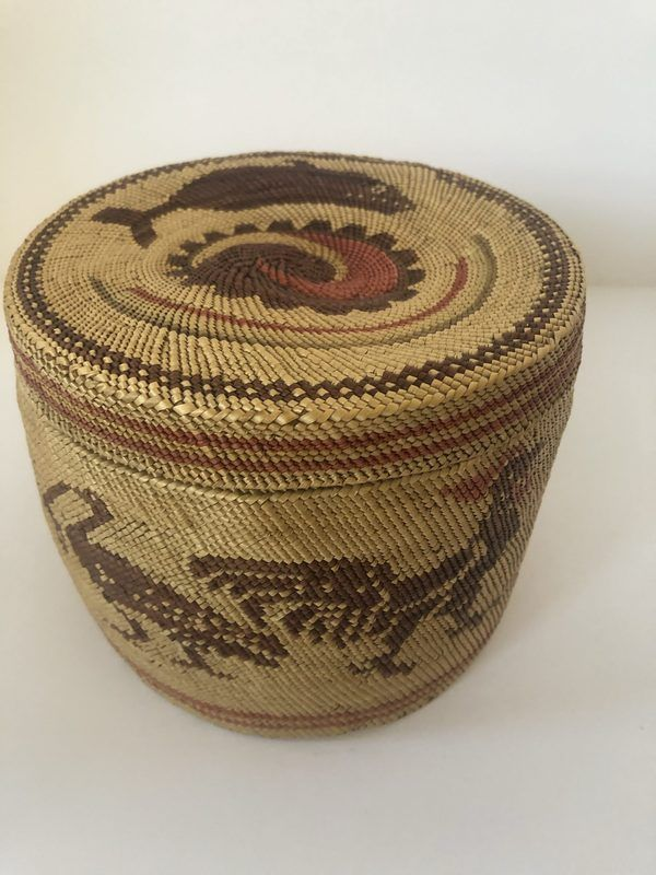 A neat Native American McCaw lidded basket. Basket includes chicken and whale figures.