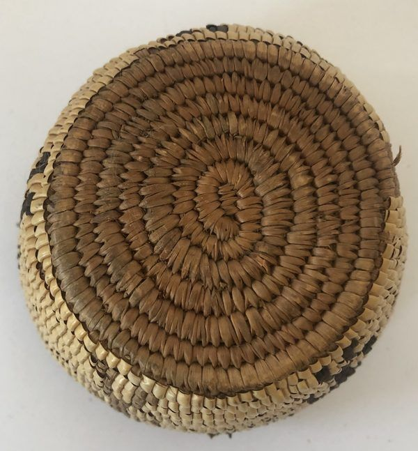Here is a neat little Native American Northwest Coast basket with four people figures. This basket is in very good condition.