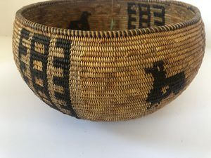 "A Native American Mission basket with a bird design. Measures 10"" wide X 4 1/2"" tall"