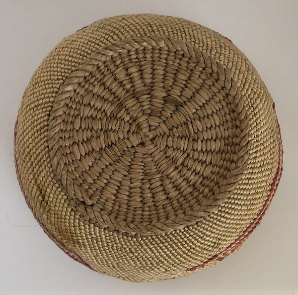 A Native American Pacific Northwest basket with three American flags. This basket is in really good condition but does have a few minor imperfections, including a small area that appears to have been repaired.