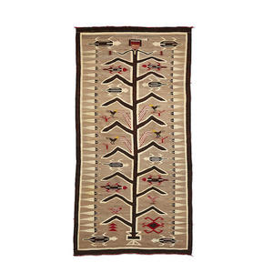"A Navajo Pictorial rug with a tree of life design. Also has lizards and birds . Measures 93"" X 47"""